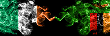 Republic of Ireland, Irish vs Zambia, Zambian smoky mystic flags placed side by side. Thick colored silky abstract smoke flags. Stock fotó