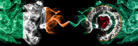 Republic of Ireland, Irish vs United States of America, America, US, USA, American, Worcester, Massachusetts smoky mystic flags placed side by side. Thick colored silky abstract smoke flags.