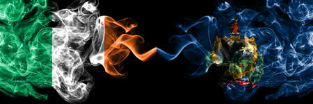 Republic of Ireland, Irish vs United States of America, America, US, USA, American, Vermont smoky mystic flags placed side by side. Thick colored silky abstract smoke flags. Stock fotó