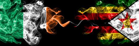 Republic of Ireland, Irish vs Zimbabwe, Zimbabwean, Zimbo smoky mystic flags placed side by side. Thick colored silky abstract smoke flags. Stock fotó