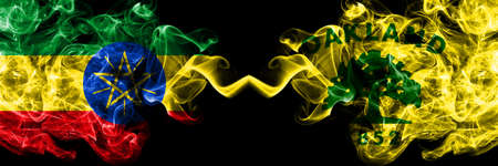 Ethiopia, Ethiopian vs United States of America, America, US, USA, American, Oakland, California smoky mystic flags placed side by side. Thick colored silky abstract smoke flags.