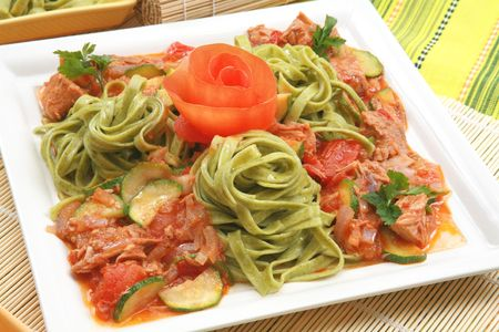 Meat with vegetables and pasta photo