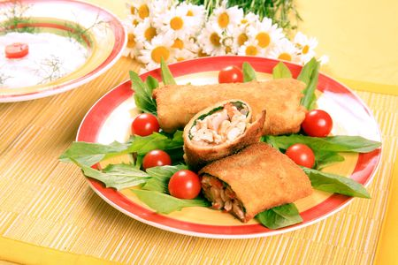 Breaded pieces of fish in pancakes