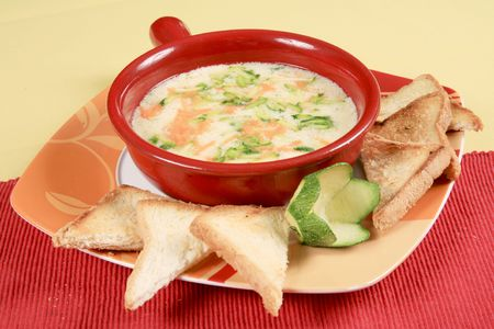 Zucchini soup with grated cheese