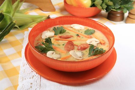Vegetable soup with mushrooms and sausages Stock Photo