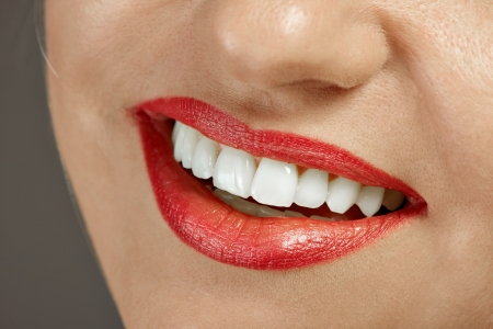 Close up woman mouth, and white teeth, and red lips photo