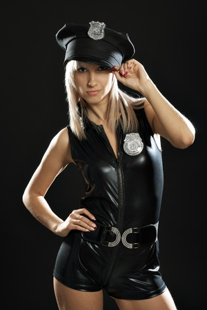 Portrait blondy woman in police girl suit in dark Stock Photo - 10101697