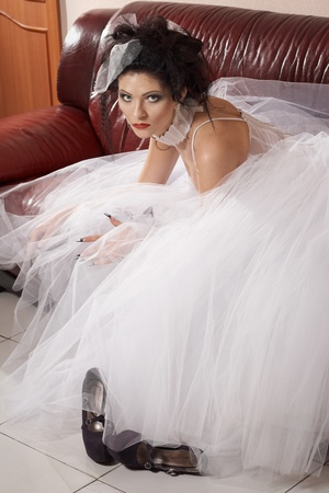 Beauty and fashion glamour model in brides dress, and creative hair style photo
