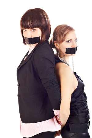 mention: Two young woman with closed mouth Electrical tape against white background
