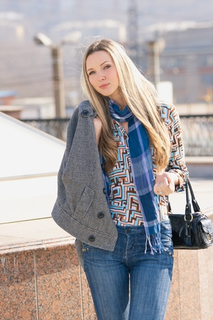 Young fashion model walking at the city Stock Photo - 10343622