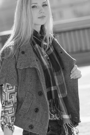 Young fashion model walking at the city photo