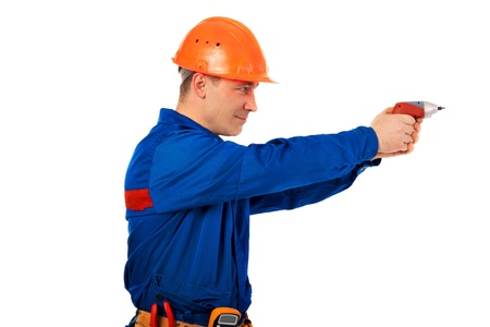 Tachnician man working class with equipment against white background Stock Photo - 10350470