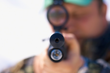 Close up hunter aiming with weapon at the outdoor hunting 版權商用圖片