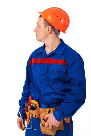 Tachnician man working class with equipment against white background Stock Photo - 10350479
