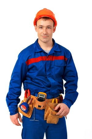 Tachnician man working class with equipment against white background Stock Photo - 10350478