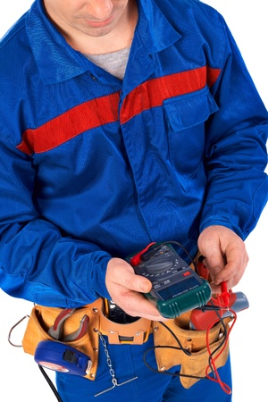Technician man working class with equipment against white background Stock Photo - 10364617