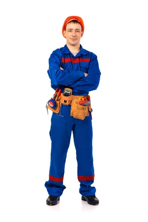 Tachnician man working class with equipment against white background full-length Stock Photo - 10364597