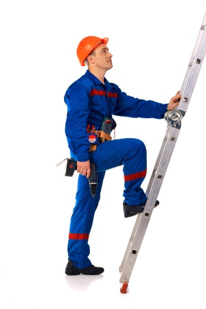 ladder safety: Portrait technician man in workwear with instrument and step-ladder Stock Photo