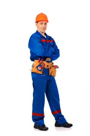 Tachnician man working class with equipment against white background full-length Stock Photo - 10364598