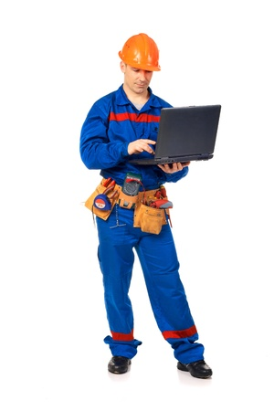 Workek man with laptop in workwear against white photo
