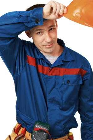 Work man in workwear with instrument in studio against white background photo