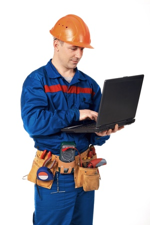 personal computers: Workek man with laptop in workwear against white