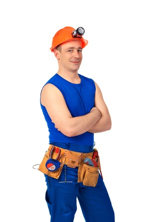 fold ones arms: Technician in work wear after job against white background