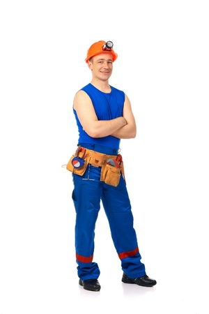 Technician in work wear after job against white background Stock Photo - 10399769