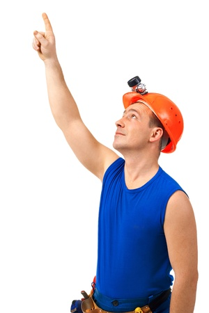 Technician in work wear point to the up against white background Stock Photo - 10417362