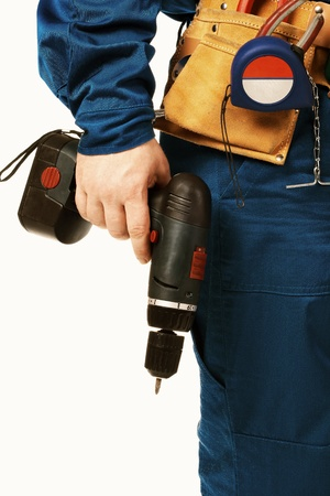 body work: Close up body work man in workwear with instrument and drill against white Stock Photo