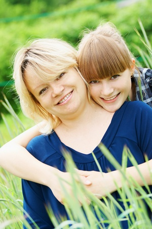 fold ones arms: Portrait mother and daughter in fold in one