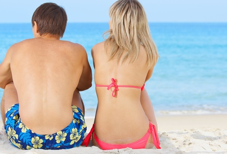 love affair: Two young people on the beach near sea Stock Photo