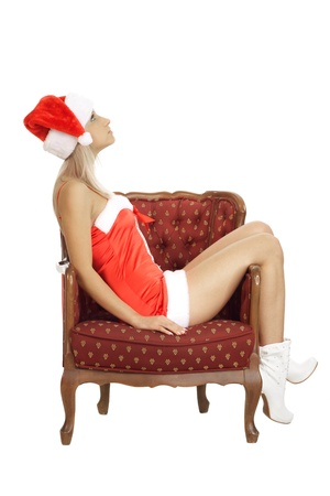 Sexual christmas girl in white studio on the chair Stock Photo - 11114504