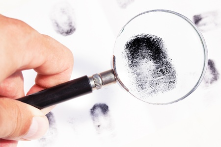 Close up magnifier and magnification finger-print jn the white background Stock Photo - 11344926