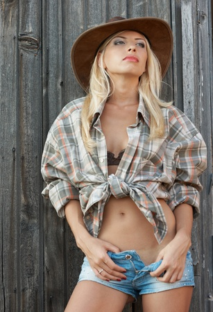 jeans skirt: outdoor fashion portrait cowgirl in hat in the western village outdoor