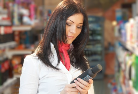 Young girl near counter choosing article in shop Stock Photo - 11595466