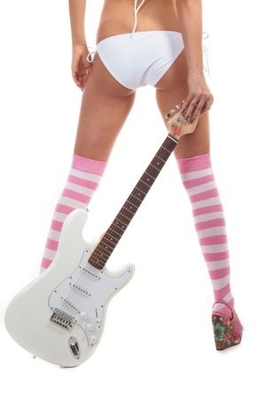 Pin-up back girl in underwear on white background with guitar Stock Photo