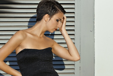 Portrait young brunet model with short hair against wall Stock Photo - 11807267