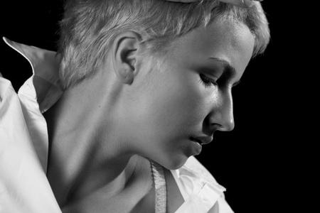 vouge: Portrait young beauty girl against black background