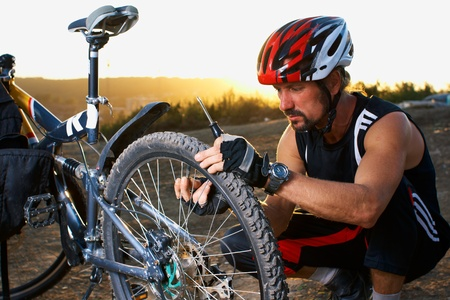 Evening outdoor sport shooting man with bike