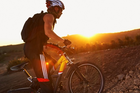 Evening outdoor sport shooting man with bike photo