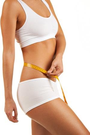 Close up portrait woman body with measurement ribbon
