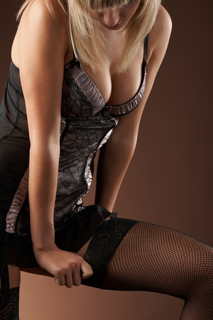 Woman body in studio in sexual lingerie photo