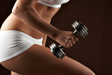 dumbbells: Close up woman body with dumbbel