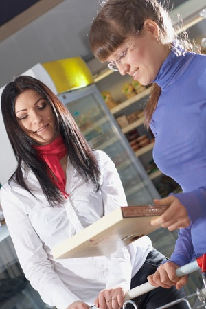 Two young girl choosing food in super market Stock Photo - 12269828