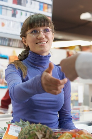 Young girl payment debit card in shop Stock Photo - 12269853