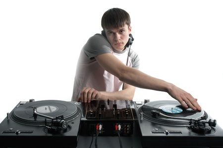 Young disk jockey for thw vinyl disks and mixer photo