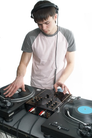 Young disk jockey for thw vinyl disks and mixer Stock Photo - 12269908