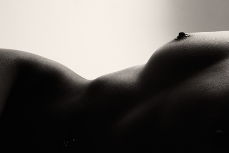 Close up woman torso in nude in black and white, added film noise Stock Photo