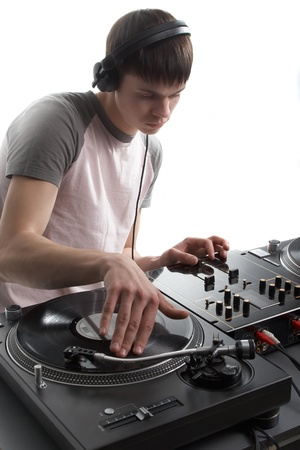 disk jockey: Young disk jockey for thw vinyl disks and mixer